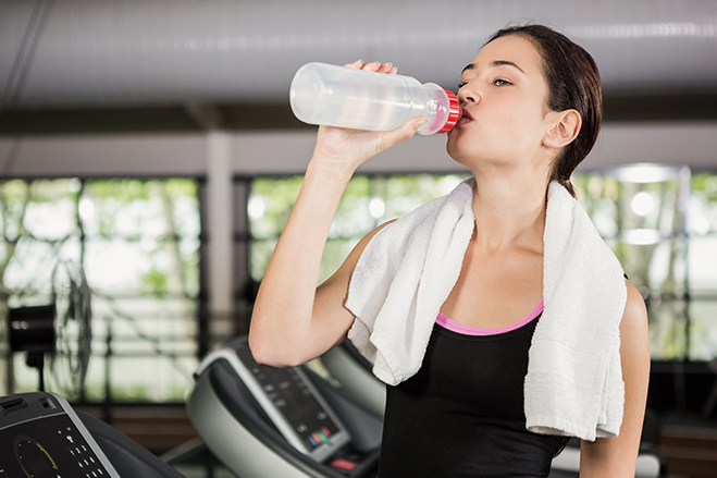 Girl Drinking Water in Gym