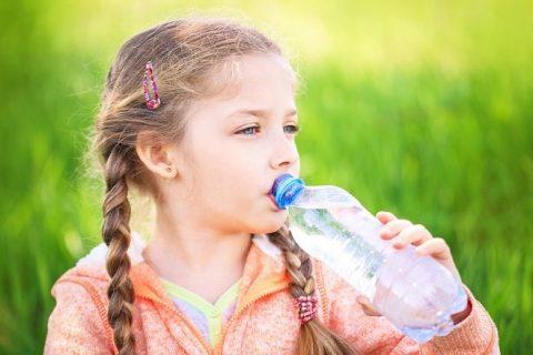 Girl Drinks Water from Bottle